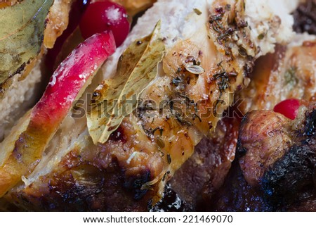 fried meat baked ham with oranges apples and berries - stock photo