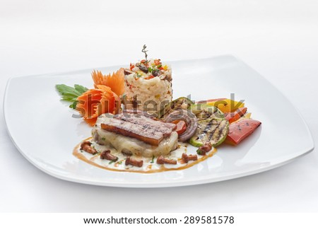 Fried meat stake with cheese, ham, white rice and vegetables on a white background