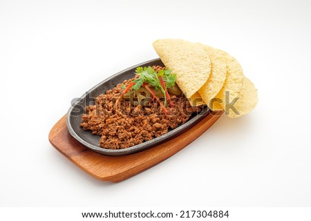 Fried minced lamb meat with loaf on a hot plate - stock photo
