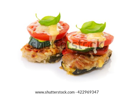 Fried mincemeat baked chops with vegetables and cheese.
