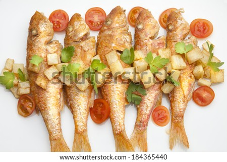 fried mullet with potato and parsley - stock photo