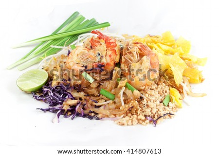 Fried noodle Thai style with prawns. Stir fry noodles with shrimp in (Pad Thai) Thai Cuisine on  white color wrapper food.