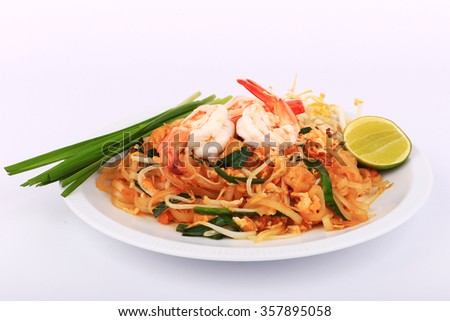 Fried noodle Thai style with prawns, Stir fry noodles with shrimp in padthai style on table. Front view isolate white - stock photo