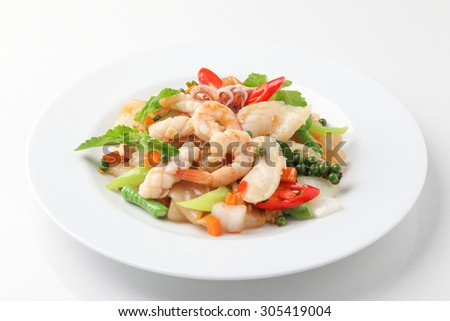 Fried Noodle with Mixed Seafood with Vegetable in soybean Sauce - stock photo