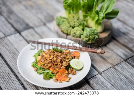 fried noodle with soy sauce for asian food style in plate - stock photo