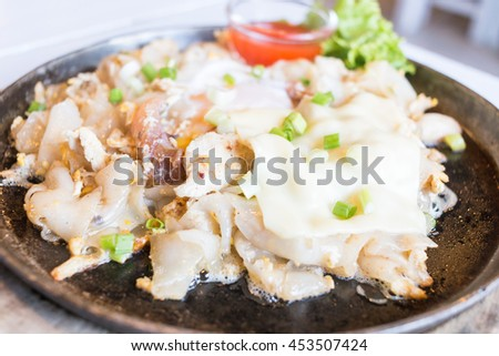 Fried Noodles with Chicken and cheese on top