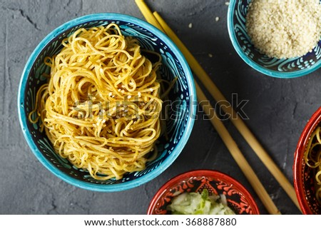 Fried noodles with sesame seeds - stock photo