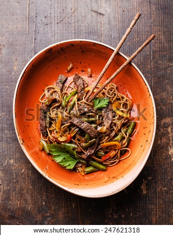 Fried noodles Yakisoba with beef on red plate - stock photo
