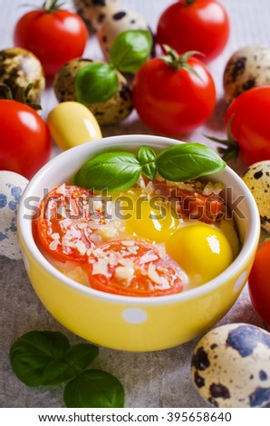 Fried of quail eggs with tomatoes and cheese in a batch manner. Selektivgy focus. - stock photo