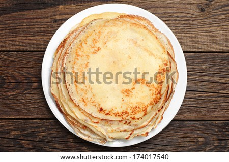 Fried pancakes on old wooden table. Top view - stock photo