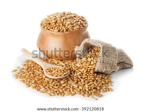 Fried peeled sunflower seeds in bowl and a bag, a wooden spoon isolated on a white background closeup - stock photo