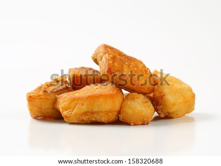 fried pieces of pork greaves