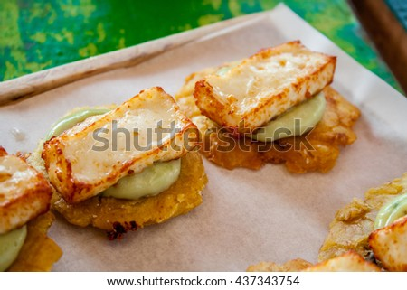Fried plantain toston (patacon) with fried cheese