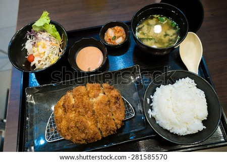 Fried pork and japanese rice in the bento set - stock photo