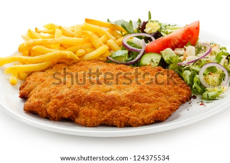 Fried pork chop French fries and vegetables - stock photo