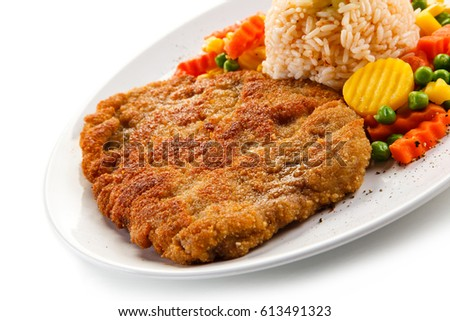 Fried pork chop with rice and vegetables
