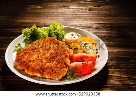 Fried Pork Chops And Vegetable Salad