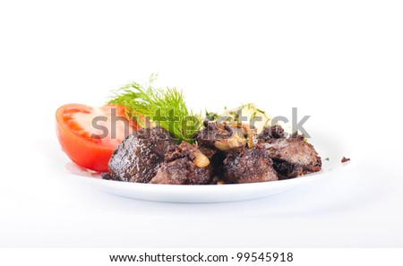 Fried pork liver with tomatoes and potatoes - stock photo