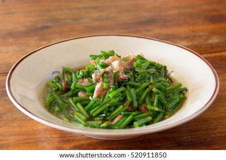 Fried pork with chinese chives