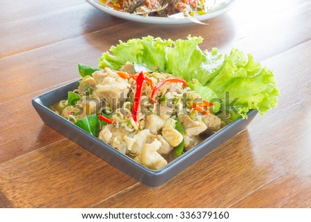 fried pork with lemongrass on wood table