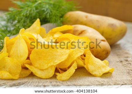 Fried potato chips with salt and fennel - stock photo