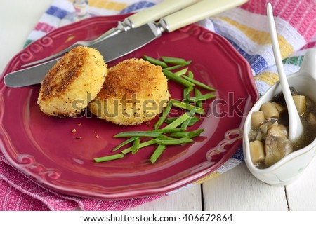 Fried potato cutlets /patties/ with mushroom sauce - stock photo