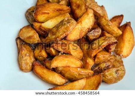fried Potato on white plate. Fast food.