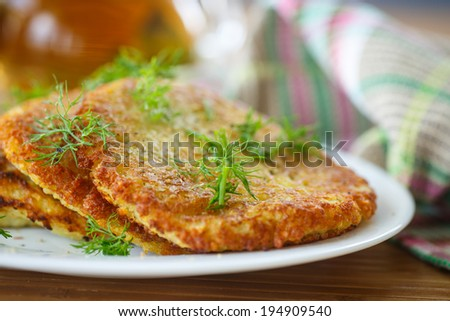 fried potato pancakes on a plate with dill