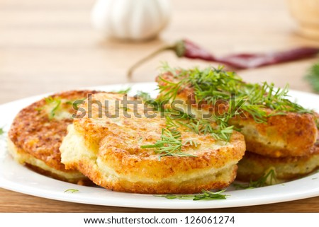fried potato pancakes with dill on a plate - stock photo