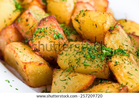 Fried potato slices with dill  - stock photo