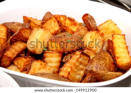 Fried potato wedges close up in white bowle