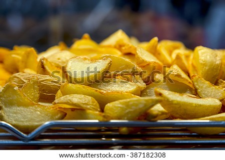 Fried potatoes and nuggets on the grill