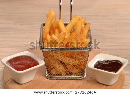 Fried potatoes chest and sauces dip. - stock photo