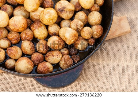 fried potatoes in skin, delicious food - stock photo
