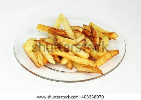 fried potatoes on a glass plate white background