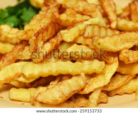 fried potatoes on a plate closeup