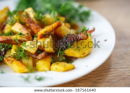 fried potatoes with bacon and dill on a plate