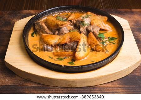 Fried Potatoes With Chicken Giblets in a Skillet - stock photo
