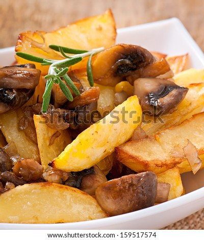 Fried potatoes with mushrooms and onions