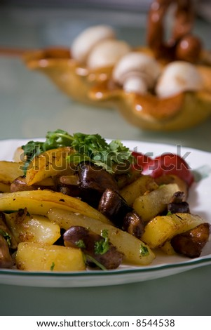 Fried potatoes with mushrooms and spicy beets