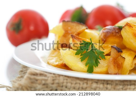 fried potatoes with slices of bacon on a white background