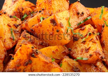 Fried potatoes with spices Asian cuisine .shallow depth of field photograph. shallow depth of field photograph.  - stock photo
