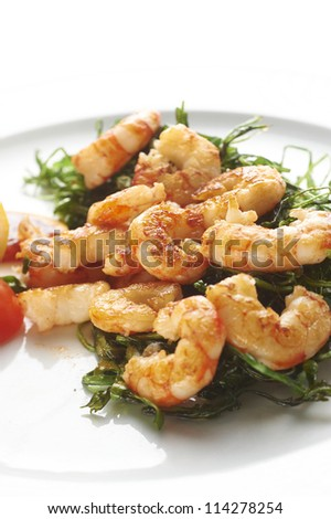 Fried prawns with fried vegetable on white plate - stock photo