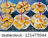 Fried Quail's egg selling at outdoor market in Thailand. - stock photo
