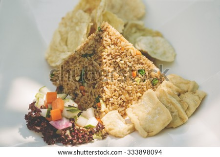 fried rice and fried tofu served with salad - stock photo