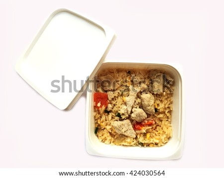 Fried Rice isolate on white background. Thai Foods - Fried Rice with Vegetables and Meat in plastic box to go. - stock photo