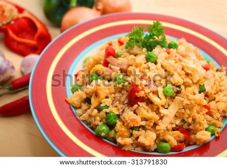 Fried Rice over wooden table background with ingredients