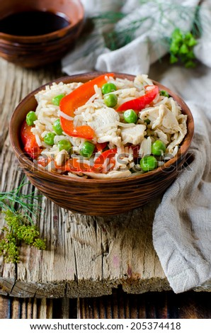 Fried rice with chicken and vegetables - stock photo