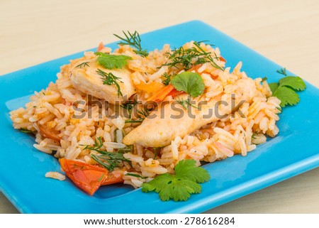 Fried rice with chicken, tomato and herbs - stock photo