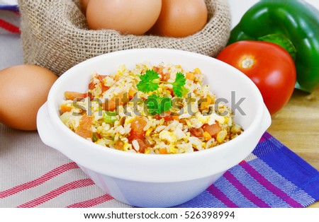 Fried rice with egg and various of vegetables. Rice and Egg menu for the children.
